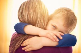 mother-son-hug-istock