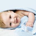 newborn-child-relaxing-bed-after-bath-shower_85523-36