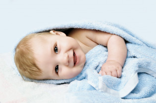 newborn-child-relaxing-bed-after-bath-shower_85523-36