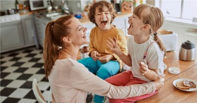 mom_laughing_with_two_kids