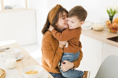 smiley-mother-son-playing_23-2148443169