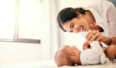 Shot of a happy mother bonding with her baby boy at home